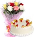 send Eggless Pineapple Cake with Roses Bouquet delivery
