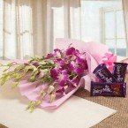 send Orchids Flower n  Cadbury Dairy Milk Fruit and Nut Chocolate delivery