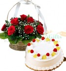 send 1Kg Eggless Pineapple Cake N Red Roses Basket delivery