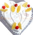 send Half Kg Eggless Pineapple Heart Shaped Cake delivery