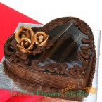 send half kg eggless heart shaped chocolate truffle cake delivery