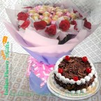 send half kg black forest cake n roses ferrero rocher chocolate bouquet  delivery