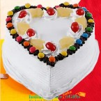 send 1kg eggless heart shaped pineapple gems cake delivery