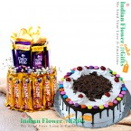 send half kg black forest gems cake with two layer chocolate arrangement delivery