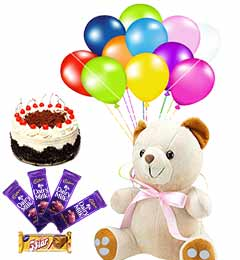 spicial combo of teddy cake chocolates and balloons