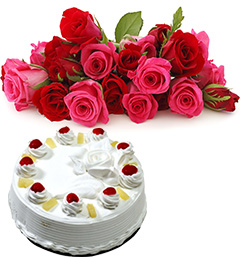 half kg Eggless Pineapple Cake and 15 Red And Pink Roses Bunch
