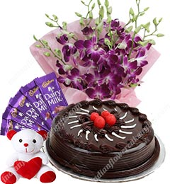 purple orchids bouquet and small chocolate cake